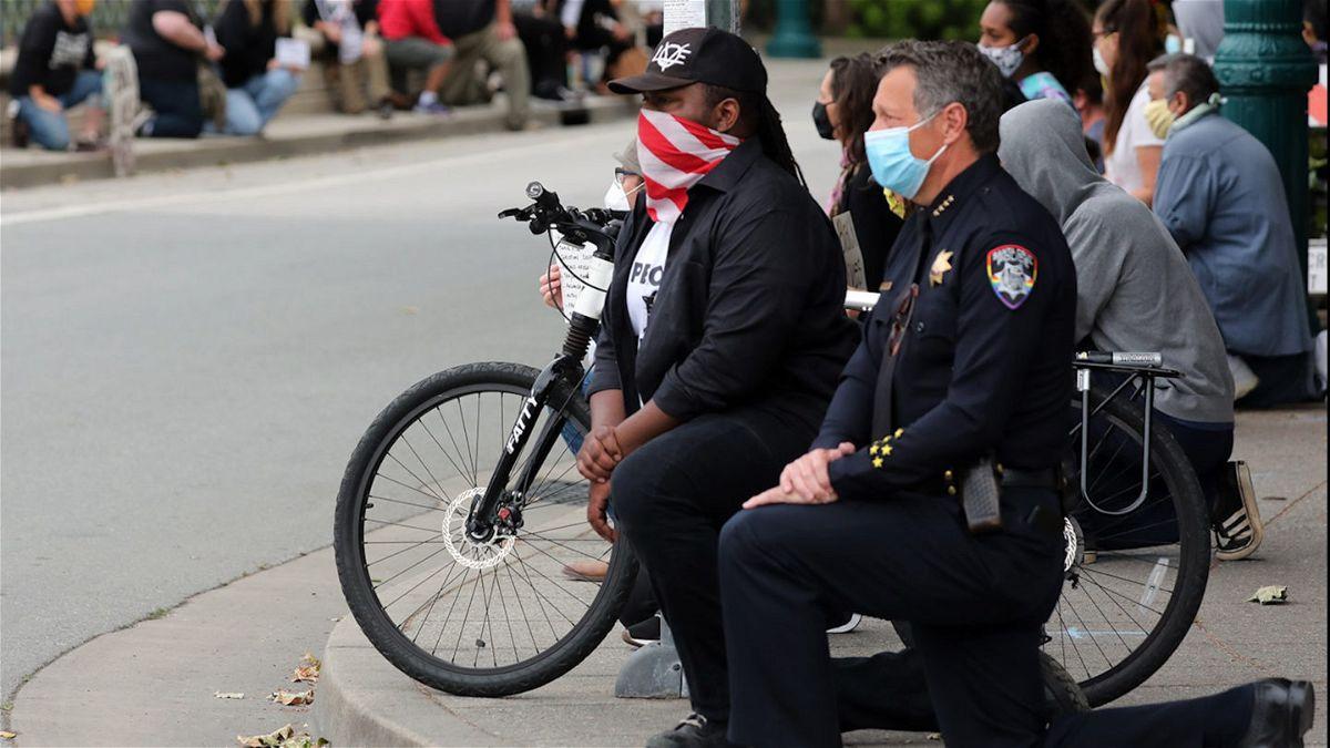 Santa Cruz Police Chief and Mayor kneel alongside protesters Saturday.