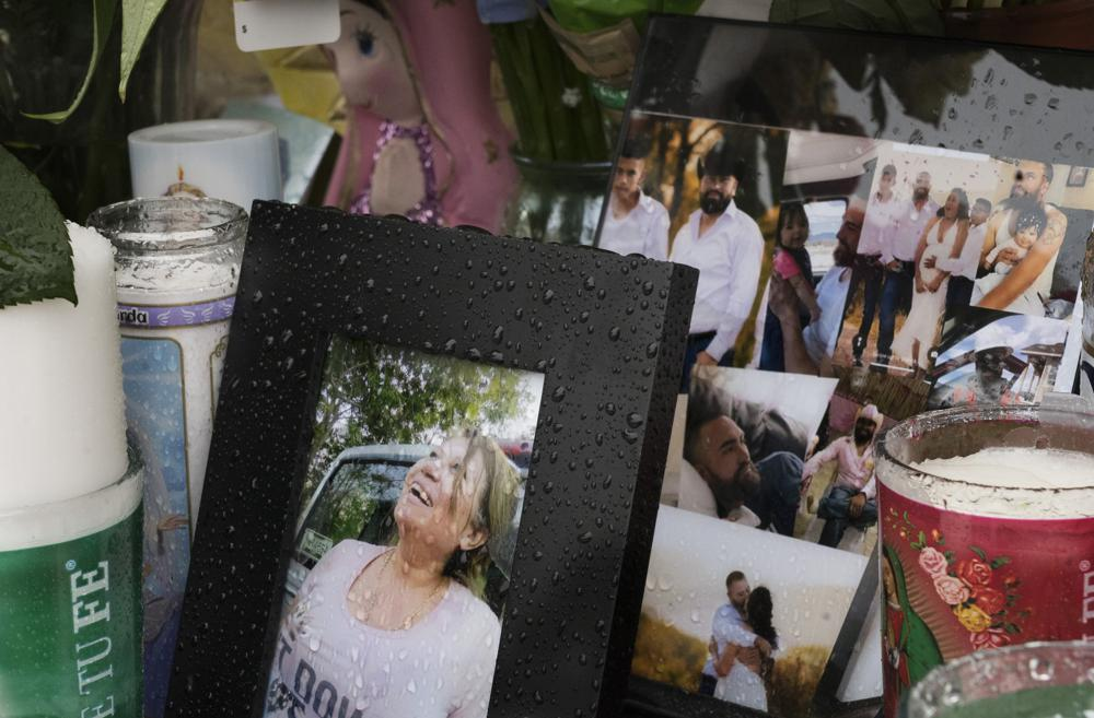 A photo of Joana Cruz, foreground, is seen at a makeshift memorial, Tuesday, May 11, 2021, in Colorado Springs, Colo. Cruz was the matriarch of the family in which six were shot to death early Mother's Day morning. Authorities say the man who fatally shot six people at a birthday party before killing himself was upset after not being invited to the weekend gathering thrown by his girlfriend's family.