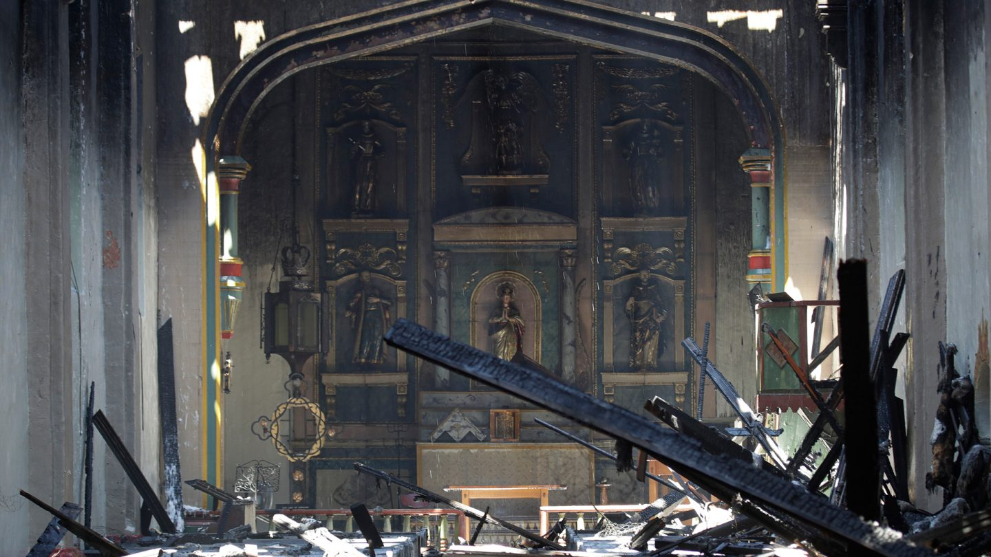 A fire that gutted much of the historic Catholic church in Southern California last year was intentionally set by a 57-year-old man, prosecutors said Tuesday, May 4, 2021. John David Corey faces multiple felony counts including arson of an inhabited structure, the Los Angeles County District Attorney's Office said in a statement.