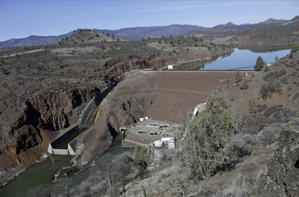 FILE - In this March 3, 2020, file photo, is the Iron Gate Dam, powerhouse and spillway are on the lower Klamath River near Hornbrook, Calif. The U.S. Bureau of Reclamation said this week that it won't release water into the main canal that feeds the massive Klamath Project irrigation system, marking the first time in 114 years that no water has flowed in the so-called A Canal. The agency announced last month that irrigators would get dramatically less water than usual, but a worsening drought picture means water will be completely shut off instead, the agency said.