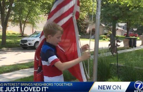 Sam Boje raises a flag for his neighbor in Omaha