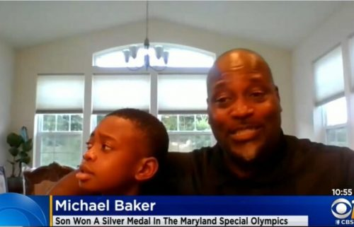 Michael Baker (right) holds his 10-year-old son
