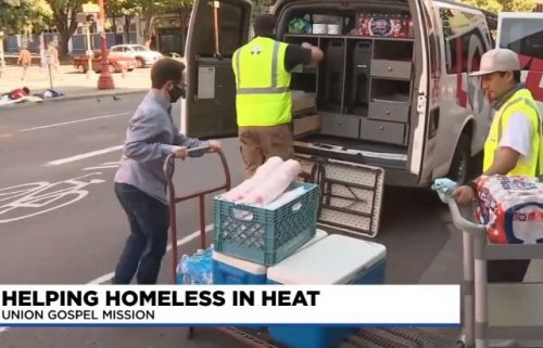 Union Gospel Mission members load a van with supplies for the homeless in Portland