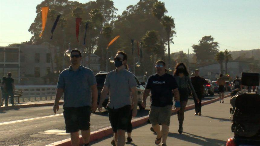 People walking through Santa Cruz Wharf on June 15th.