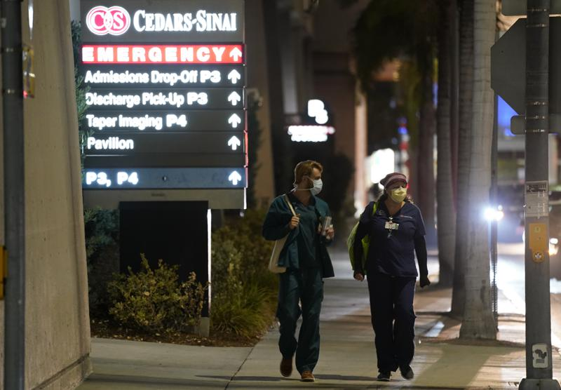 FILE - In this Jan. 5, 2021, file photo, Cedars-Sinai Medical Center workers walk outside the hospital, in Los Angeles. The California Senate has rejected a bill aimed at making it easier for some hospital workers to get workers compensation benefits.