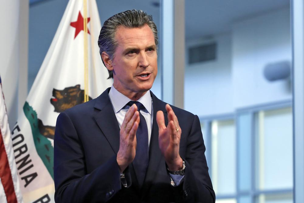 """FILE - In this April 14, 2020, file photo, California Gov. Gavin Newsom discusses an outline for what it will take to lift coronavirus restrictions during a news conference at the Governor's Office of Emergency Services in Rancho Cordova, While California will end most coronavirus rules on June 15, Gov. Gavin Newsom said Friday, June 4, 2021 he will not lift the """"state of emergency"""" that has been in place since March 2020."""