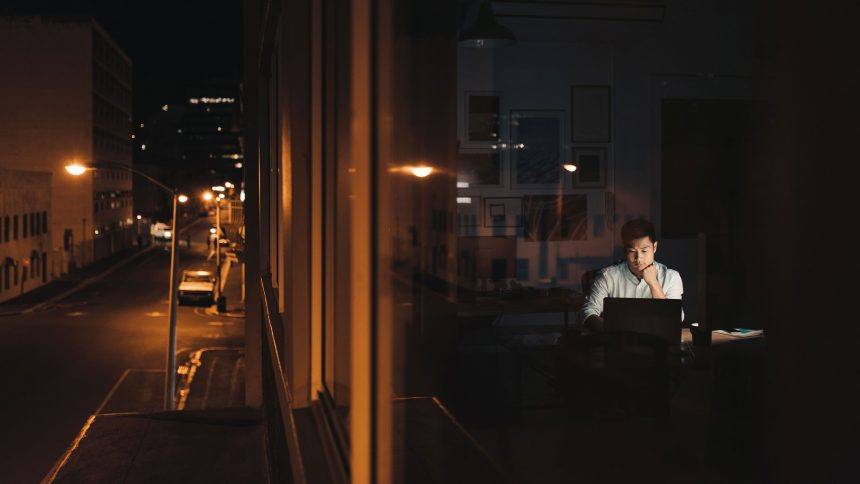 Young,Asian,Businessman,Sitting,At,His,Desk,Working,On,A