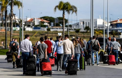 Travelers from the UK arrive in Portugal on the first day of post-restriction travel.
