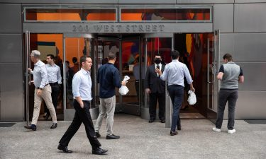 People enter the Goldman Sachs headquarters building in New York on Monday