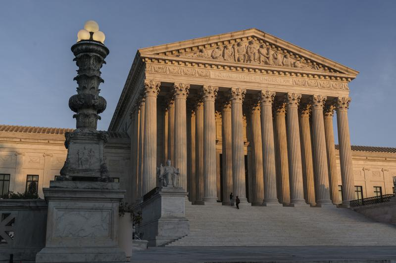 FILE - In this Nov. 6, 2020, file photo, the Supreme Court is seen at sundown in Washington. The state of California has agreed to pay more than $2 million in legal fees in a settlement with churches that challenged coronavirus closure orders. Church lawyers who successfully took their appeal to the U.S. Supreme Court said Wednesday, June 2, 2021, that the state agreed not to impose restrictions on houses of worship that are greater than those on retail businesses.
