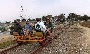 Residents take cruise on train tracks with unique handcars