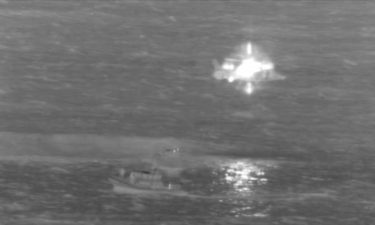 The US Coast Guard says the two cargo plane crew members were in stable condition when they were rescued by a USCG MH-65 Dolphin helicopter and a Honolulu Fire Department rescue boa
