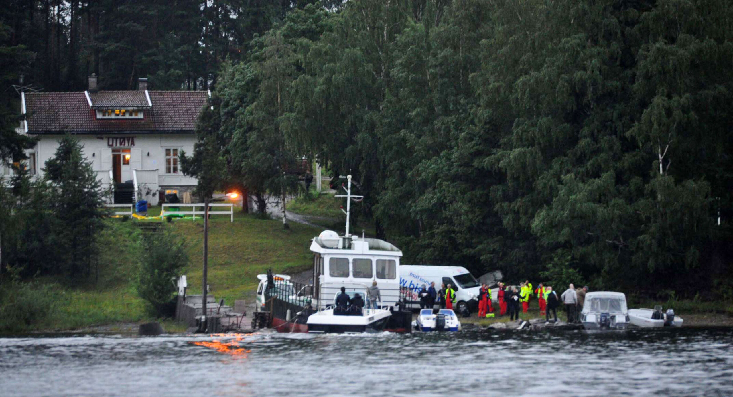 <i>Vegard M. Aas/presse30.no/Getty Images</i><br/>Police and emergency services gather following the massacre at a summer youth camp on July 22