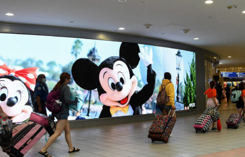 The mayor of the Florida county that's home to Disney World and Universal Studios is sounding the alarm on a spike of Covid-19 cases in the area
