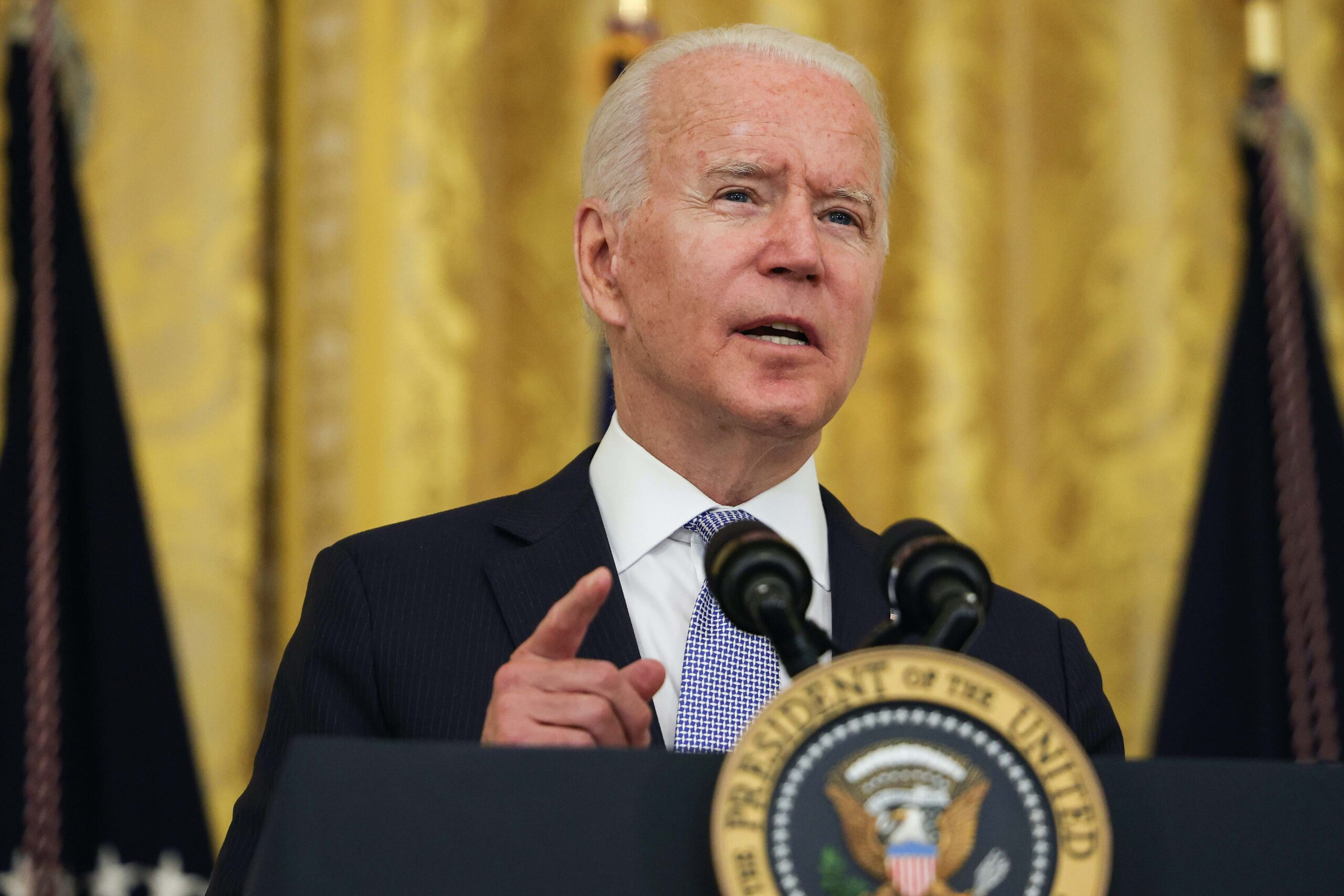 <i>Anna Moneymaker/Getty Images North America/Getty Images</i><br/>President Joe Biden will discuss applying new sanctions on the Cuban regime when he meets with Cuban-American leaders at the White House on Friday. Biden is shown here in the East Room of the White House on July 29