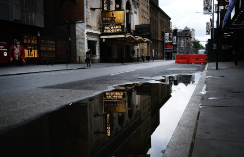 Broadway theaters stood closed along an empty street in the theater district on June 30