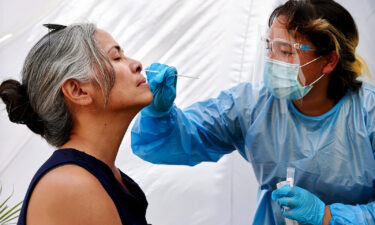 A medical assistant administers a Covid-19 test to a person at Sameday Testing on July 14 in Los Angeles. Covid-19 cases are on the rise in most states as the highly transmissible Delta variant has become the dominant strain in the United States.