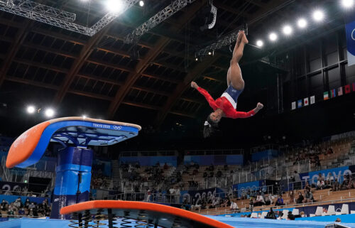 Simone Biles performs on the vault during the artistic gymnastics women's final at the 2020 Summer Olympics.