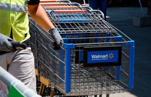 An employee gathers shopping carts at Walmart