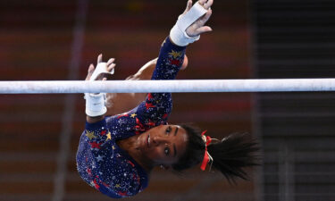 USA's Simone Biles competes in the uneven bars event of the  artistic gymnastics women's qualification during the Tokyo 2020 Olympic Games at the Ariake Gymnastics Centre in Tokyo on July 25.