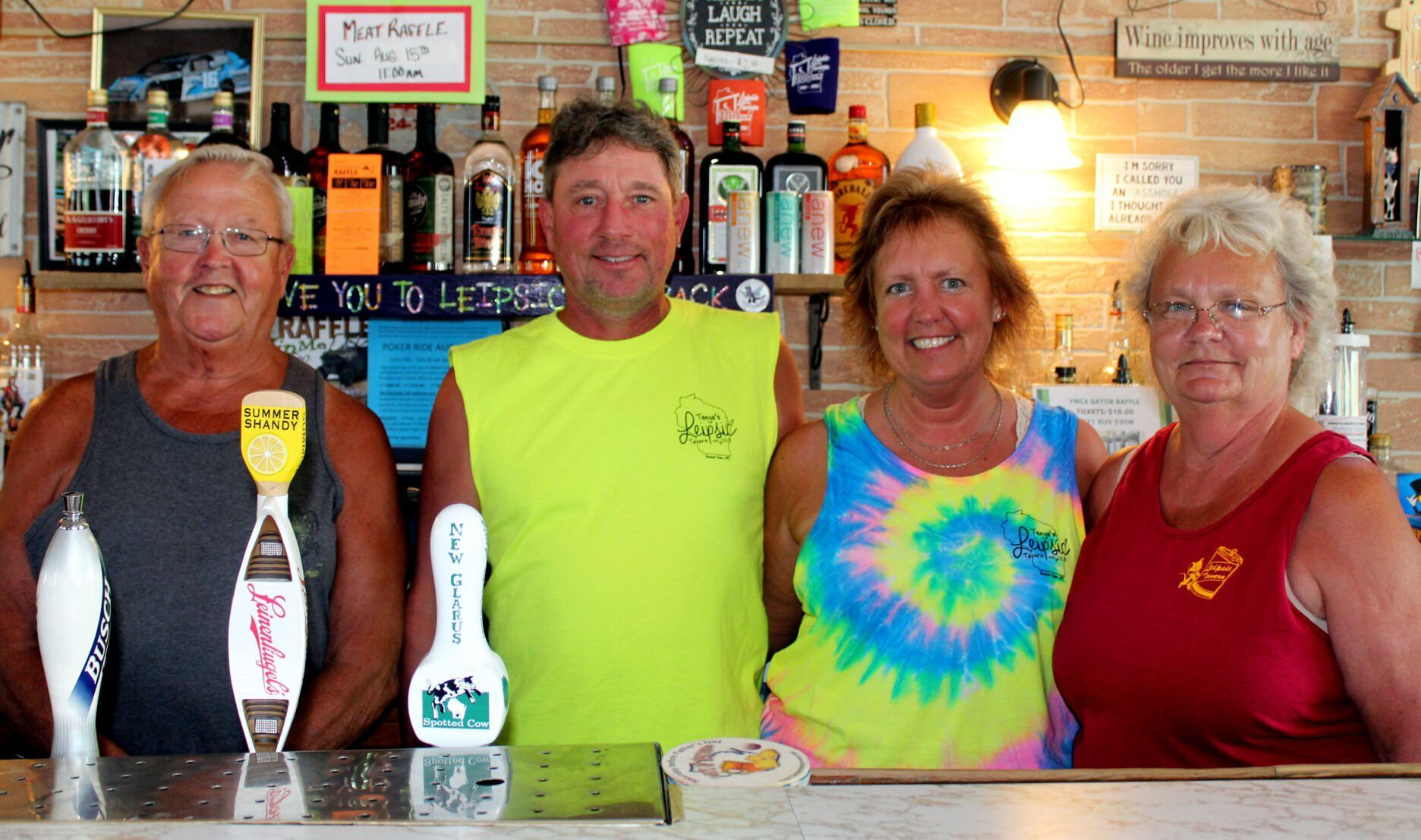 <i>TERRI PEDERSON/Daily Citizen</i><br/>The last two sets of owners of Leipsic Tavern pose behind the bar: Danny Schmitt