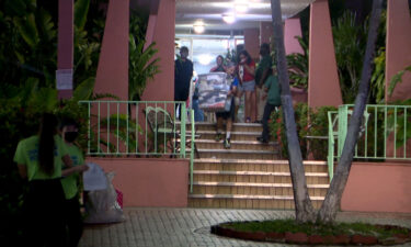 Residents evacuate a building in Miami's Flagami neighborhood.