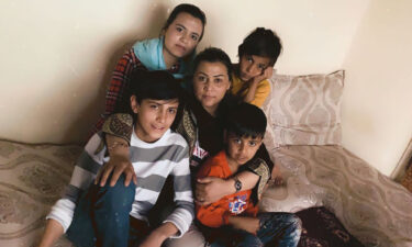 Suneeta hugs her children in this image taken earlier this year.