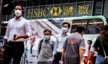 HSBC staged a strong recovery in the first half of the year. Pedestrians walk outside the HSBC Main Building in Hong Kong on August 2.