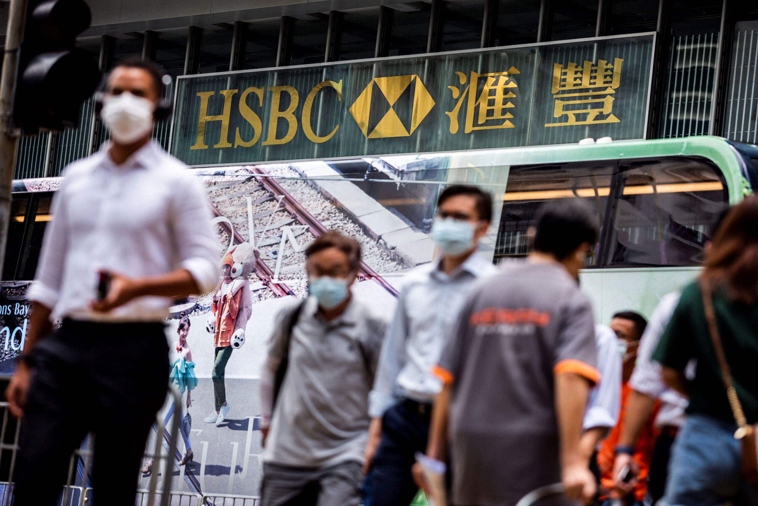 <i>Isaac Lawrence/AFP/Getty Images</i><br/>HSBC staged a strong recovery in the first half of the year. Pedestrians walk outside the HSBC Main Building in Hong Kong on August 2.