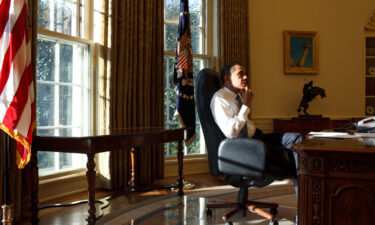 """""""Obama: In Pursuit of a More Perfect Union"""" documents Barack Obama's life and presidency. Obama is seen here in the Oval Office on his first day in office on Jan. 21"""