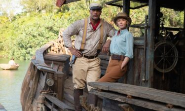 """Dwayne Johnson as Frank and Emily Blunt as Lily are seen in """"Jungle Cruise."""" After Disney hit some rough waters this week"""