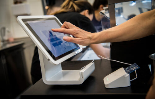Square anounced Sunday that it's buying Afterpay for $29 billion. A customer uses a Square Inc. device to make a payment in San Francisco