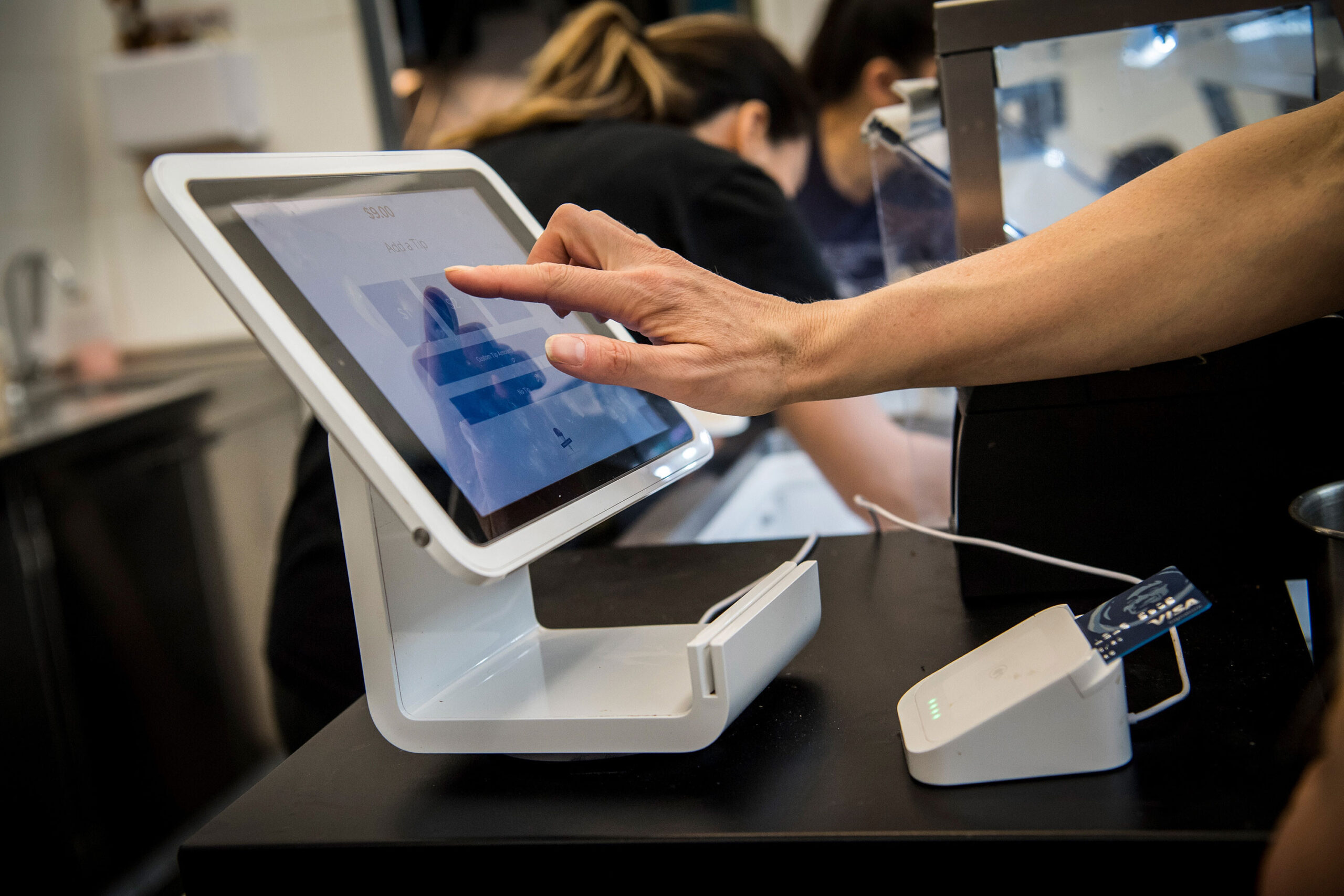 <i>David Paul Morris/Bloomberg via Getty Images</i><br/>Square anounced Sunday that it's buying Afterpay for $29 billion. A customer uses a Square Inc. device to make a payment in San Francisco