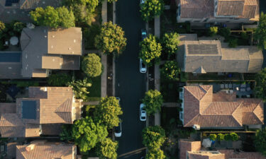 Wall Street is buying up family homes. This image shows an aerial photograph of single-family homes in San Diego