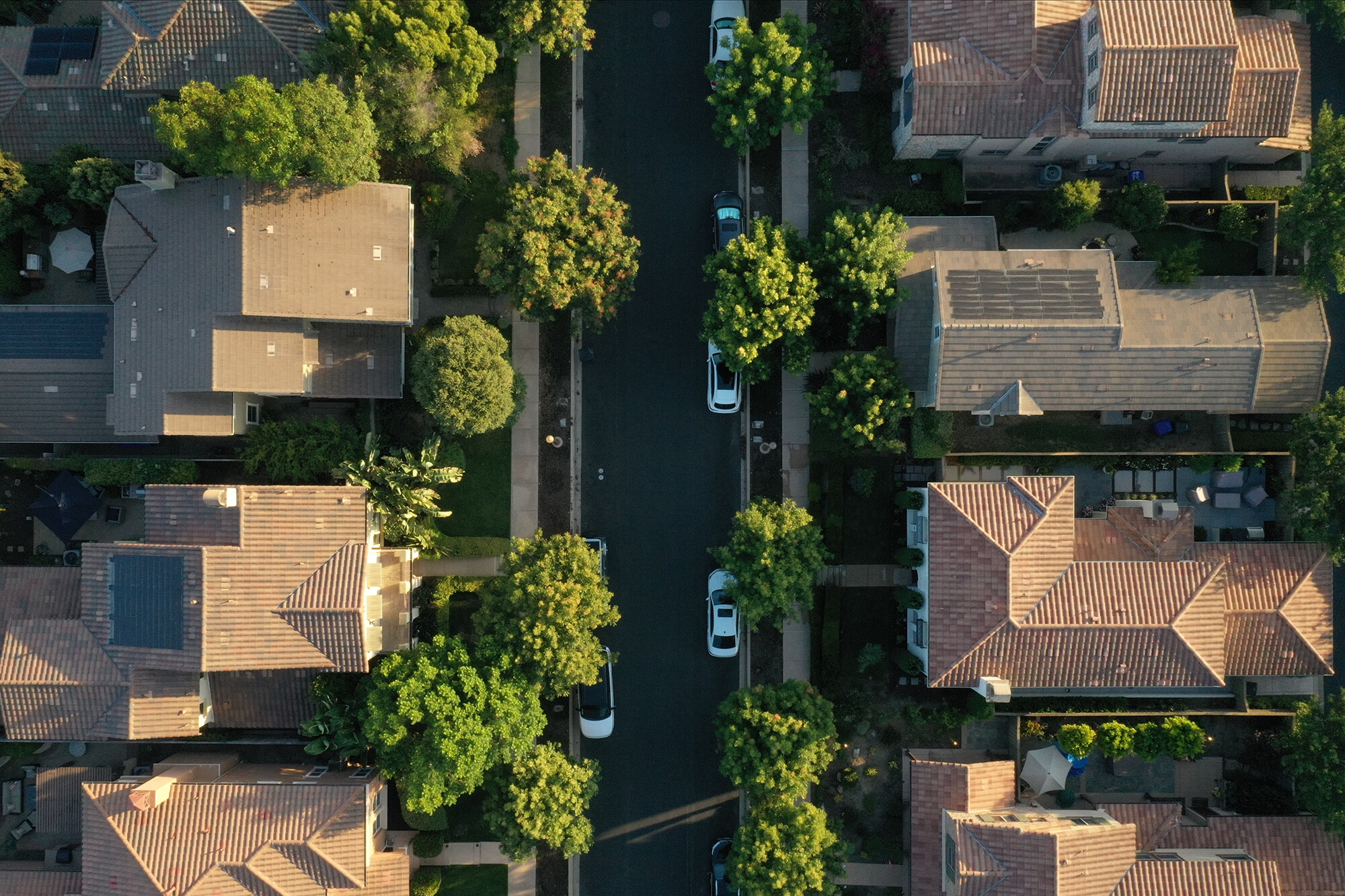 <i>Bing Guan/Bloomberg/Getty Images</i><br/>Wall Street is buying up family homes. This image shows an aerial photograph of single-family homes in San Diego