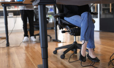 Employees at tech startup company Fast work at their desks in the office on March 24
