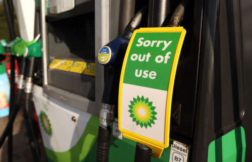 A sign reads 'Sorry out of use' on a diesel pump at a BP gas station in Brentwood