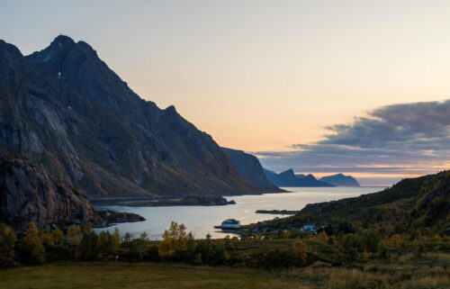 Norway moves into the 'very high' risk category for travel. The sun sets in Tangstad fjord