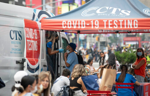 A man receives a Covid-19 test at a mobile testing site in Times Square