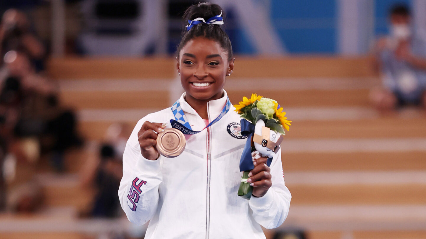 <i>Jamie Squire/Getty Images</i><br/>Biles poses with the bronze medal at Ariake Gymnastics Centre