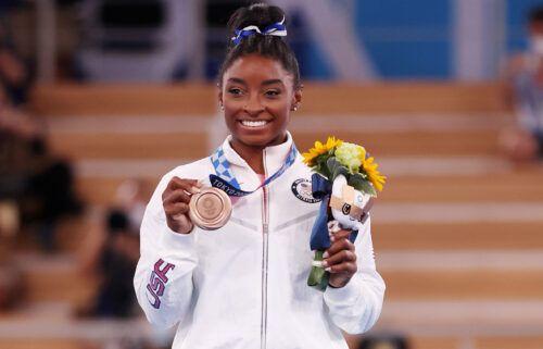 Biles poses with the bronze medal at Ariake Gymnastics Centre