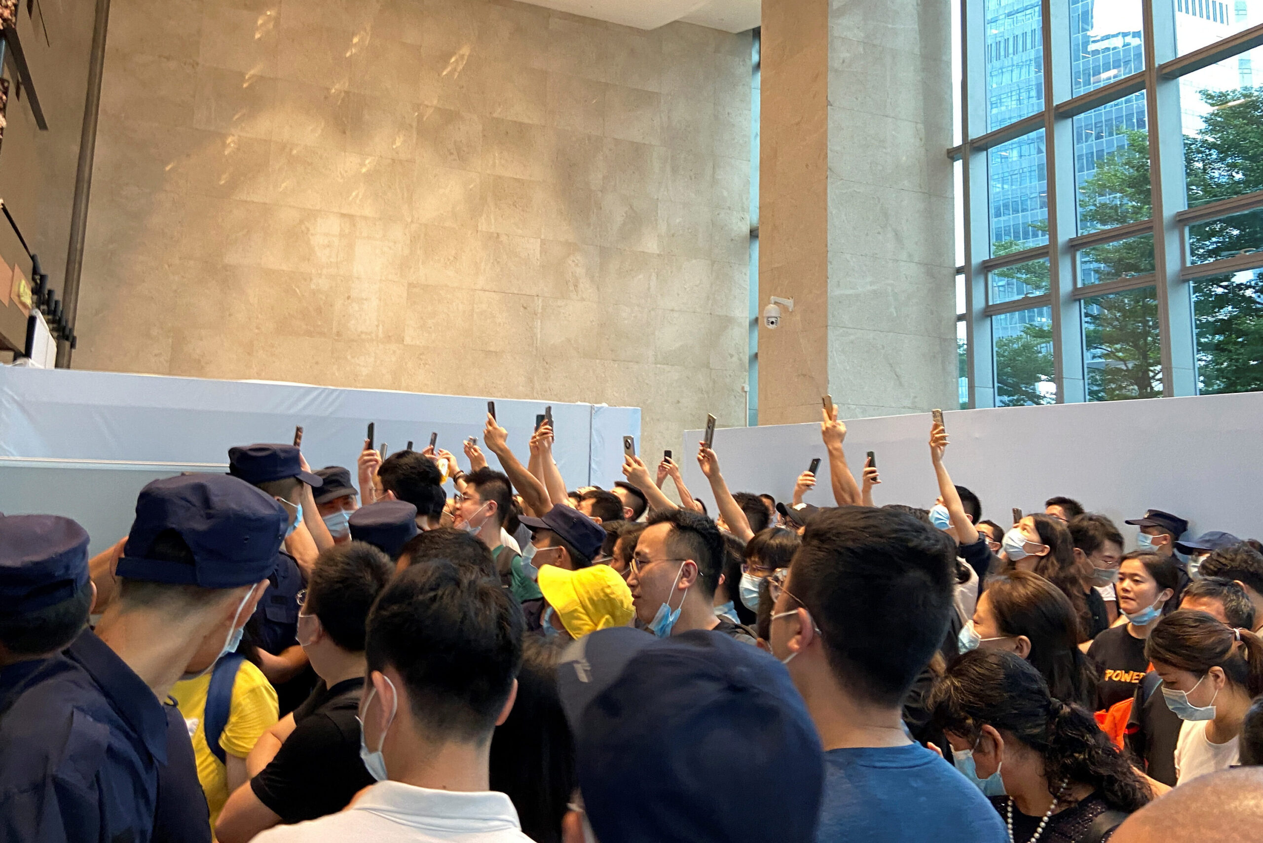 <i>David Kirton/Reuters</i><br/>People gathering to demand repayment of loans and financial products at Evergrande's headquarters in Shenzhen on Monday.