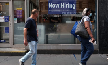 A hiring sign is displayed in a store window in Manhattan on August 19 in New York City. Only 235