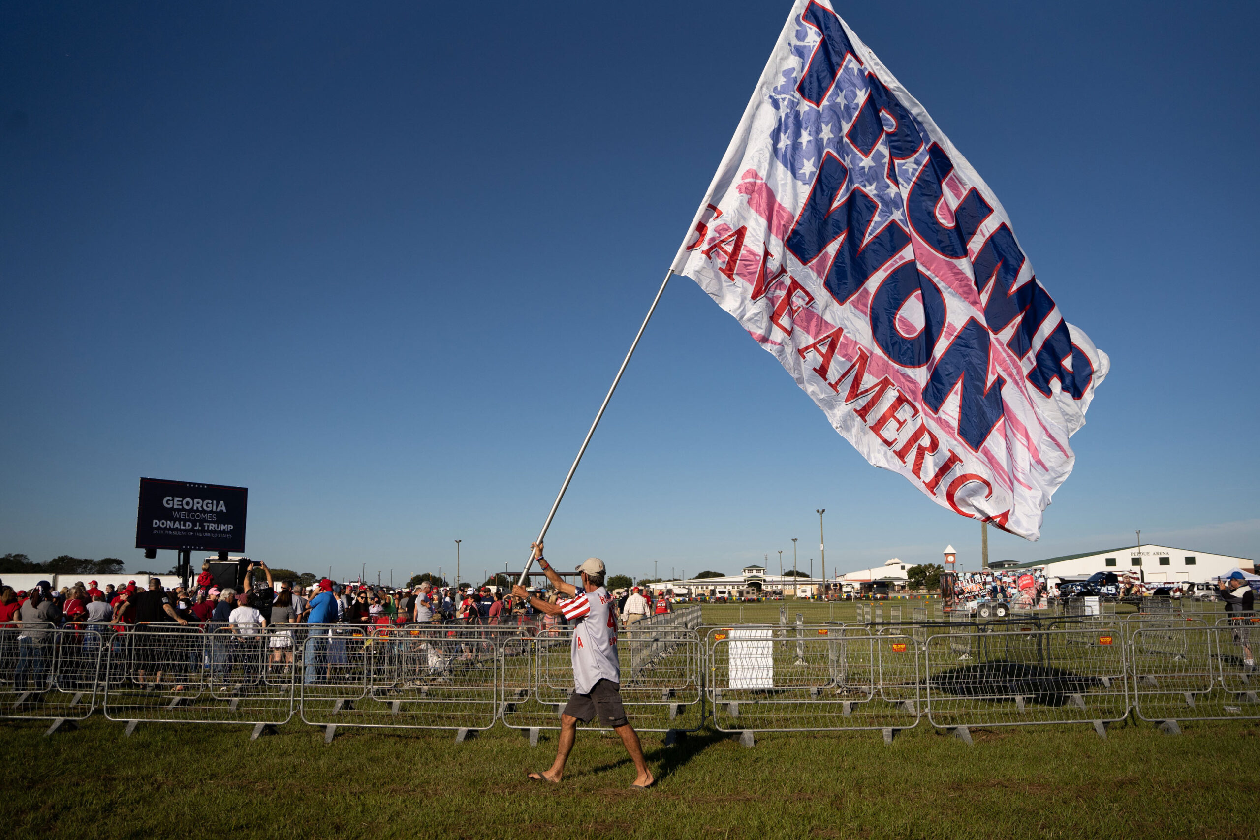 <i>Sean Rayford/Getty Images</i><br/>A man carries a flag that reads