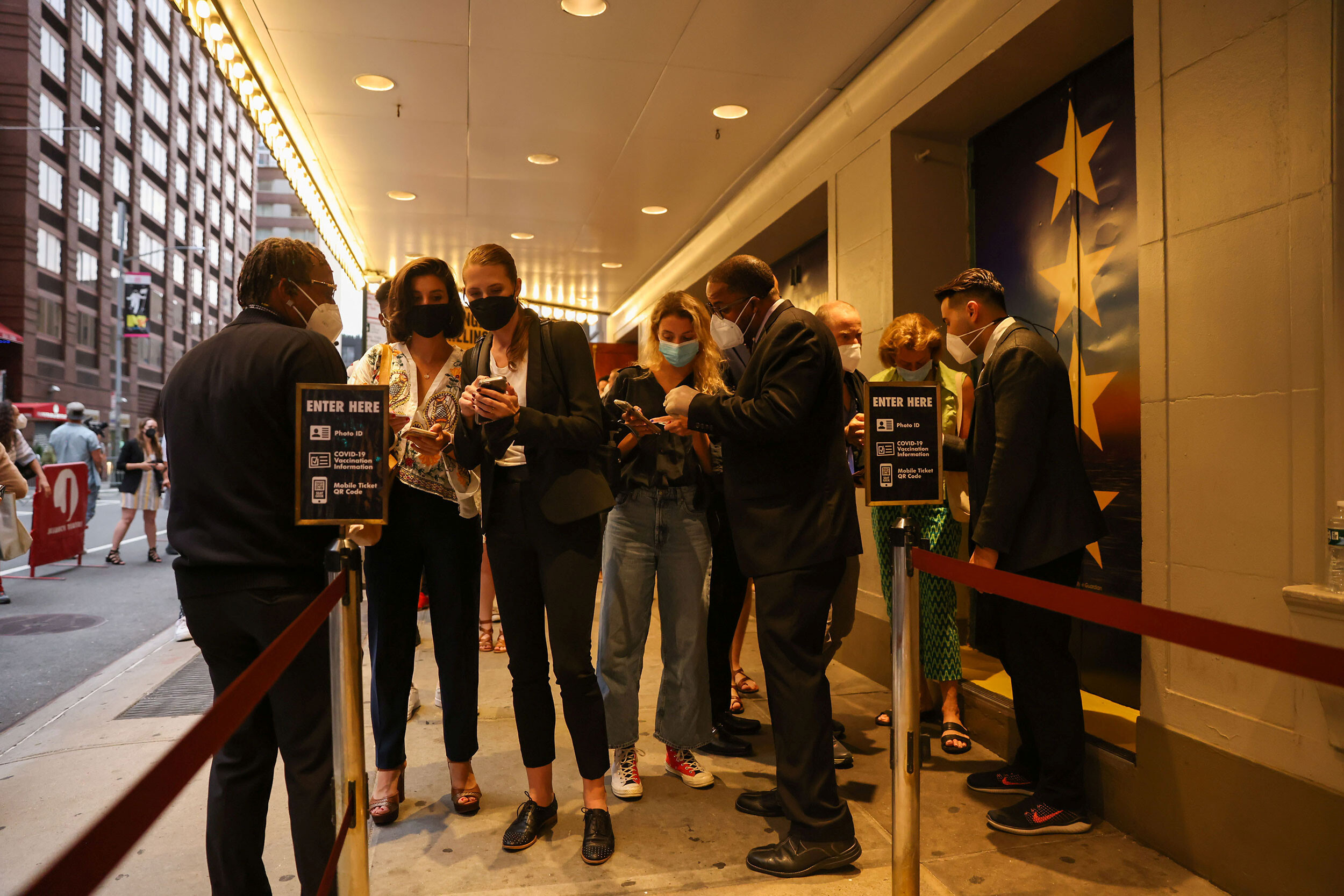 <i>Caitlin Ochs/Reuters</i><br/>Guests have their vaccine cards and identification checked before entering the theatre at the opening night of previews for