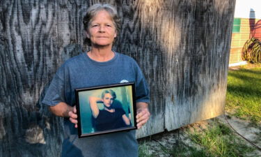 Sandy Smith holds a photo of her late son