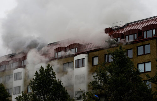 Smoke billows from a building as emergency services fight a fire caused by an explosion in central Gothenburg.