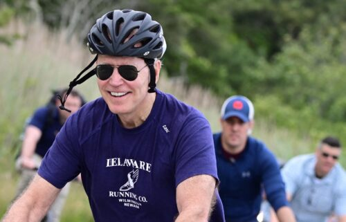 US President Joe Biden rides his bicycle in Cape Henlopen State Park on June 3