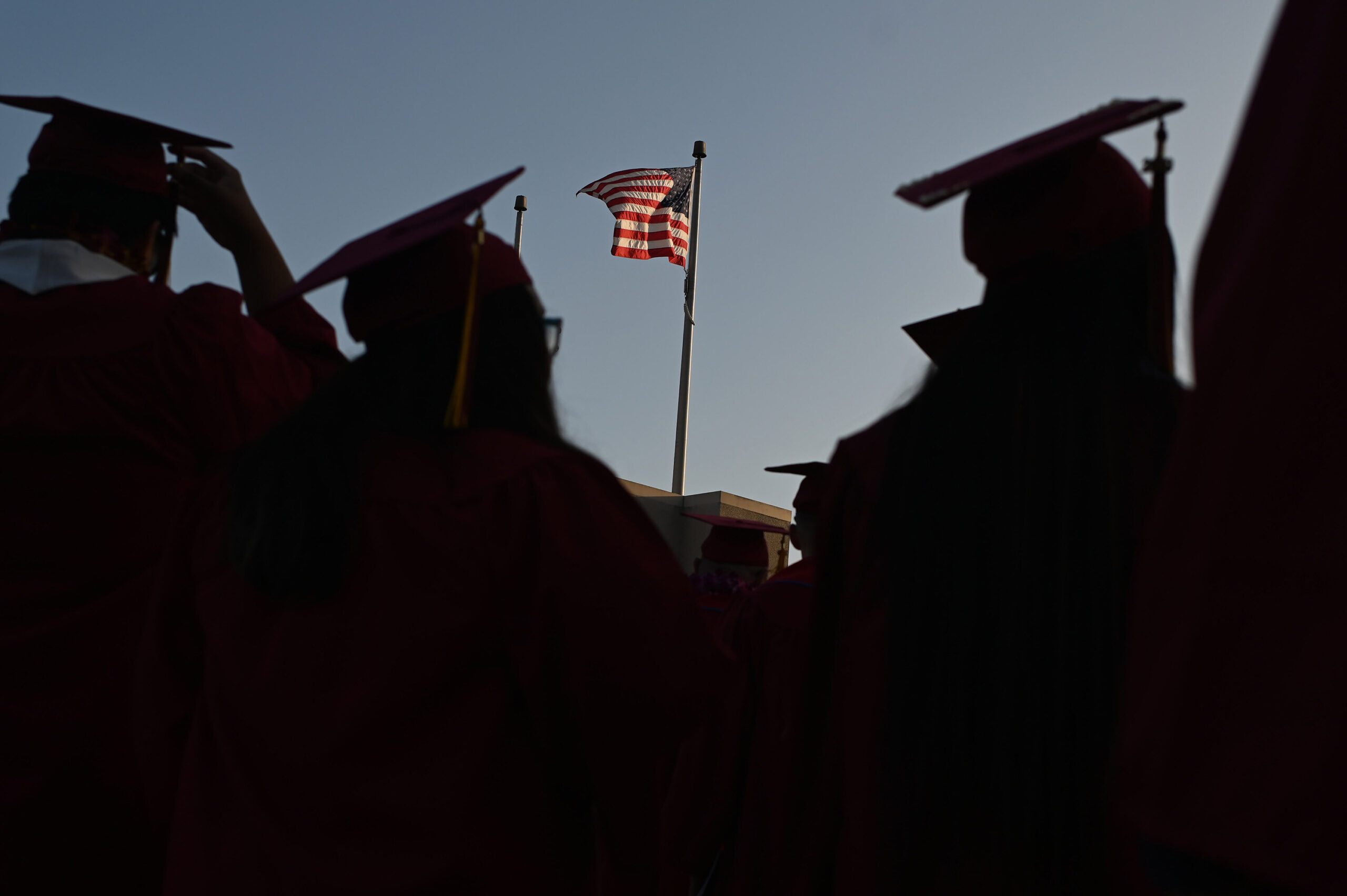 <i>ROBYN BECK/AFP/Getty Images</i><br/>The US Department of Education recently announced significant changes to a federal student loan forgiveness program. Students are seen graduating from Pasadena City College in June 2019.