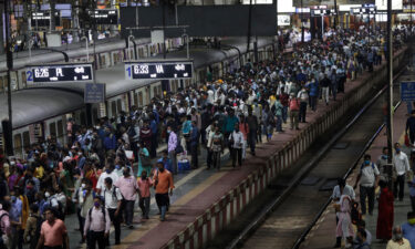 Commuters wait for local trains during peak hours at Chhatrapati Shivaji Maharaj Terminus in Mumbai on September 30